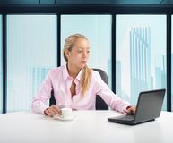 Businesswoman in her office Stock Photo