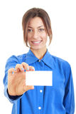 Businesswoman in her 20s in blue shirt showing blank business ca Royalty Free Stock Image