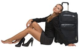 Businesswoman with her shoes off sitting hand Royalty Free Stock Photo