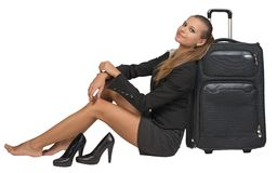 Businesswoman with her shoes off sitting next to Royalty Free Stock Photo