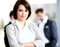 Businesswoman with her staff Stock Image