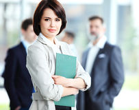 Businesswoman with her staff Royalty Free Stock Photo