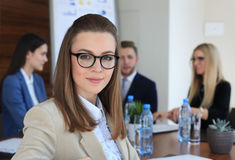 Businesswoman with her staff Stock Images