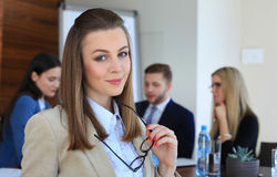 Businesswoman with her staff Royalty Free Stock Images