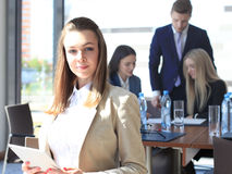 Businesswoman with her staff Stock Photography