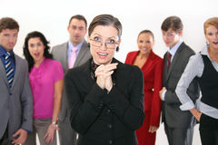 Businesswoman and her team. Surprised team of workers with a businesswomen in foreground Royalty Free Stock Image