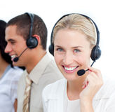 Businesswoman and her team working in a call cente Stock Photography