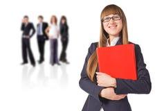 Businesswoman  with her teamwork behind Stock Photos