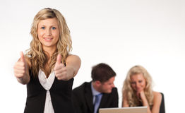 Businesswoman with her thumb up to camera. Leading a tea1 Stock Image