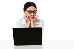 Businesswoman at her work desk, looking away Royalty Free Stock Photos
