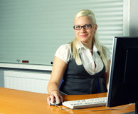 Businesswoman at her working place Royalty Free Stock Image