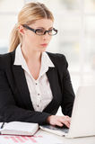 Businesswoman at her working place. Stock Image