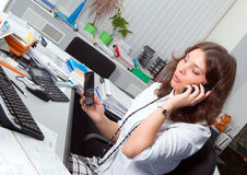 Businesswoman at her workplace. Royalty Free Stock Images