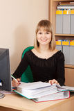 Businesswoman  on her  workplace in office Royalty Free Stock Photo