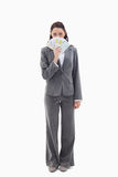 Businesswoman hiding with bank notes in her hand Royalty Free Stock Image