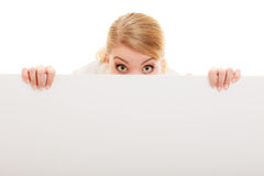Businesswoman hiding behind blank copy space banner. Advertisement. Funny woman hiding behind blank copy space banner isolated on white. Businesswoman Royalty Free Stock Photography
