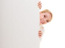 Businesswoman hiding behind blank copy space banner Royalty Free Stock Photography