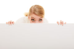 Businesswoman hiding behind blank copy space banner. Advertisement. Funny woman hiding behind blank copy space banner isolated on white. Businesswoman Stock Photography