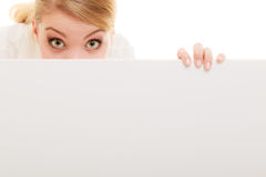 Businesswoman hiding behind blank copy space banner Stock Images