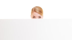 Businesswoman hiding behind blank copy space banner. Advertisement. Funny woman hiding behind blank copy space banner isolated on white. Businesswoman Royalty Free Stock Image