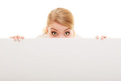 Businesswoman hiding behind blank copy space banner. Advertisement. Funny woman hiding behind blank copy space banner isolated on white. Businesswoman Royalty Free Stock Images