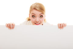 Businesswoman hiding behind blank copy space banner. Advertisement. Funny woman hiding behind blank copy space banner isolated on white. Businesswoman Stock Photos