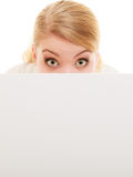 Businesswoman hiding behind blank copy space banner Stock Image