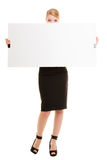 Businesswoman hiding behind blank copy space banner Royalty Free Stock Image