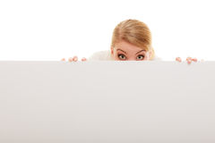Businesswoman hiding behind blank copy space banner. Advertisement. Funny woman hiding behind blank copy space banner isolated on white. Businesswoman Stock Image