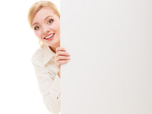 Businesswoman hiding behind blank copy space banner. Advertisement. Happy woman hiding behind blank copy space banner isolated on white. Businesswoman Stock Photo