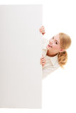 Businesswoman hiding behind blank copy space banner Stock Photos