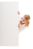Businesswoman hiding behind blank copy space banner Royalty Free Stock Photos