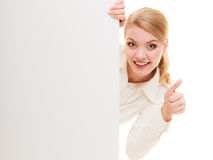 Businesswoman hiding behind blank copy space banner. Advertisement. Woman hiding behind blank copy space banner showing thumb up isolated. Businesswoman Stock Image