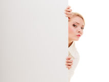 Businesswoman hiding behind blank copy space banner. Advertisement. Worried woman hiding behind blank copy space banner isolated on white. Businesswoman Royalty Free Stock Photo