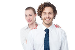 Businesswoman hiding behind her coworker Royalty Free Stock Photo