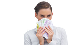 Businesswoman hiding behind money Royalty Free Stock Photos