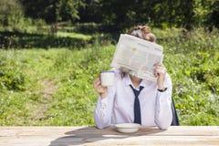 Businesswoman hiding behind a newspaper. Business woman hiding behind a newspaper Royalty Free Stock Photo