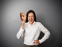 Businesswoman hiding her anger Royalty Free Stock Images