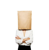 Businesswoman hiding under paper bag Royalty Free Stock Photo