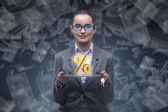 The businesswoman in high interest rates concept. Businesswoman in high interest rates concept Royalty Free Stock Photos