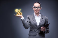 The businesswoman in high interest rates concept. Businesswoman in high interest rates concept Stock Photo