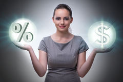 The businesswoman in high interest rates concept Stock Image