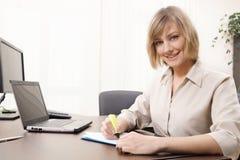 Businesswoman highlighting chart Stock Image