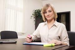 Businesswoman highlighting chart Stock Photo