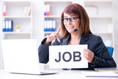 The businesswoman hiring new employees in office. Businesswoman hiring new employees in office Stock Photography