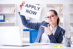 The businesswoman hiring new employees in office. Businesswoman hiring new employees in office Stock Photo