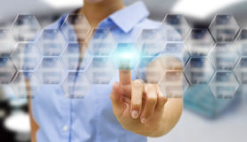 Businesswoman in his office using tactile interface Stock Image