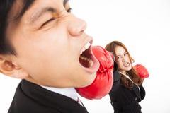 Businesswoman hitting businessman Stock Photography