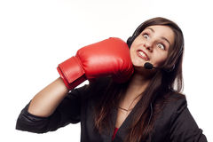 Businesswoman hitting herself with boxing gloves Royalty Free Stock Photography