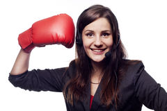 Businesswoman hitting herself with boxing gloves Stock Images
